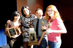 Students pose with host Dana Gentry after winning several awards for their news program, Rout(e) 131.<br>Photo Credit: Tom Rizzo