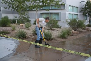Engineer Mr. Steven Deberardinis pushes away the excess water to clear the area in front of the D building.&lt;br /&gt;Photo Credit: Southwest Shadow Staff