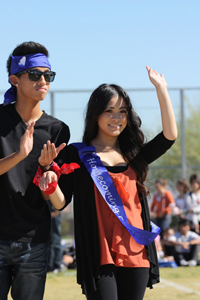 Seniors Henson Nguyen and Nadia Manivong walk on the field as the homecoming court is announced. The winners will not be recognized until tomorrow's dance.<br />Photo Credit: June Gabriel Santos