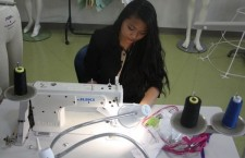 Fashion Club Vice-President Michelle Manuel prepares another one of her creations to show.Photo Credit: RJ Reyes