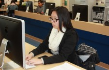 FBLA President Flora Shi looks for pretests for her Accounting event test.Photo Credit: RJ Reyes