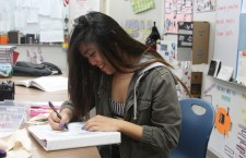 Abigayle Andoy, sophomore, sketches out one of her ideas for her skirt design.Photo Credit: Allison Ho