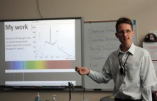 Physicist Ross Tucker presents his PowerPoint to the class about quantum mechanics.Photo Credit: Bree Eure