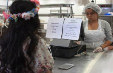 Cafeteria worker Sarah Molina takes a students order as part of her job. 