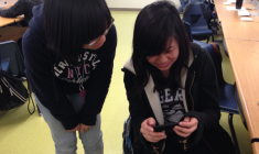 Freshmen Emerald Liu and Solange Nhan watch their finished Vine video before turning it in.  Photo Credit: Jen Chiang