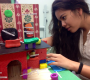 "Sophomore Karen Velayo shows off one of the Spanish homes. Describing each item, she also commented on how long it took each group to finish their house. ""My fingers were so tired of creating furniture,"" Velayo said ""But I feel maybe i'm a better artist now.""  Photo Credit: Saramei Kalaoram"