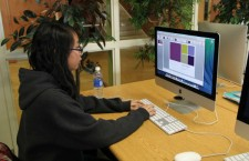 """Freshman Francesca Ngo discovers different features of PowerPoint. This application along with others were made available to students on Jan. 1. """"Microsoft helps a lot with my schoolwork. I use it on a regular basis,"""" Ngo said.  Photo Credit: Jenika Chiang"""
