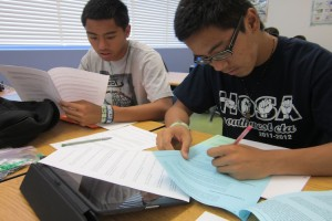 Senior Calvin and Melvin Suratos work diligently to maintain their grades before graduation.Photo Credit: Nathalie Saligumba