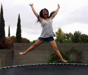 Ashley Tolentino jumps up as high as she can on a trampoline while bonding with other Sudent Council students.<br />Photo Credit: Kristelle Dealca