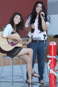 Seniors Gabrielle Silveroli and Tina Tsoi perform Jessie J's 'Pricetag' with Tsoi on guitar and Silveroli on vocals at SWCTA's Coyote's Unite last year.<br />Photo Credit: Jordan Sutton