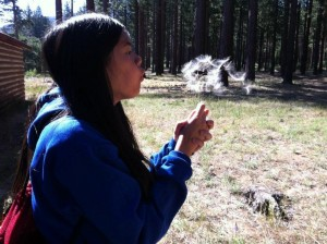 Senior Kristelle Dealca takes a moment to wish on a dandelion during Girl's State Leadership Conference this summer.<br />Photo Credit: Bserat Ghebremicael