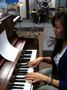 Senior Le Mai practices a piano piece for her upcoming church performance.<br />Photo Credit: Bserat Ghebremicael