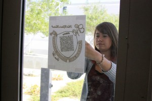"""Sophomore Janay Hagans scans a QR code outside the """"D Building"""" during a scavenger hunt for her Web Design class. <br />Photo Credit: Bailey Jones"""