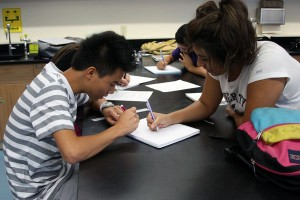 Juniors Skyler Pang and Vivian Rivera share their PBL ideas during their Physics class on the first day of school. <br />Photo Credit: Bree Eure
