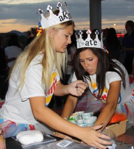 Makinzey Marracco and Katelyn Hendricks, seniors, complete their senior crowns during Senior Sunrise. The Class of 2013 hopes this is the first of many senior activities.<br />Photo Credit: Bserat Ghebremicael