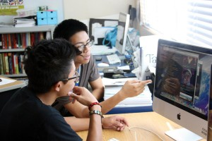 """Juniors Nikko Alcaraz and Julian Pascual search for famous rap artists to brainstorm ideas for the upcoming talent show. """"I want to show a lot more skill this year. I want to be remembered by others even when I graduate,"""" said Alcaraz.<br />Photo Credit: Jacob Berroya"""