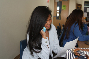 Sophomore Aundie Soriano reads off a script as she surveys Nevada citizens in Ms. Boivie's room on Oct. 25.<br />Photo Credit: Raymond Tang