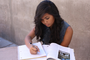 During lunch on October 10th, 2012, sophomore Aundie Soriano silently reads her World History textbook for more information about her topic for the NHD project.<br />Photo Credit: Shantil Gamiao