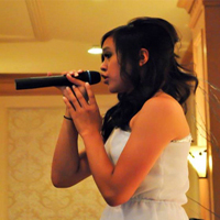 Sophomore Trixia Dela rosa sings at a friends graduation party this summer.<br/>Photo Credit: Courtesy of Trixia Dela Rosa