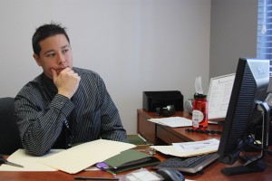 Mr. Alan Yee reviews emails from the staff as part of his new responsibilities as dean.<br />Photo Credit: Jordan Sutton