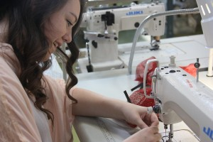 Senior Sarah Greenburg constructs her first garments for her product line.<br />Photo Credit: Jenika Chiang
