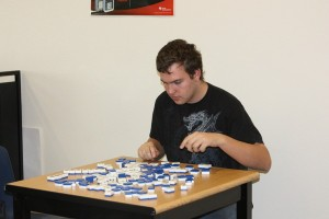 Senior Adam Montijo is shuffling the mahjong tiles as he learns how to play in Mr. Lane's room on Nov. 5.<br />Photo Credit: Raymond Tang