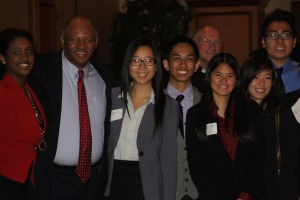 Senior Bserat Ghebremicael, CCSD Superintendent Dwight D. Jones, seniors Yu Ying Shi, Jon Dulay, Co-Founder of Volunteers in Medicine of Southern Nevada Gard Jameson, seniors Kristelle Dealca, Nha Trang Vivian Sam and junior Rayden Sisomphou take a photo to commemorate the Mayor's Prayer Breakfast.<br />Photo Credit: Helena Lagos