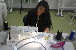 Fashion Club Vice-President Michelle Manuel prepares another one of her creations to show.<br />Photo Credit: RJ Reyes