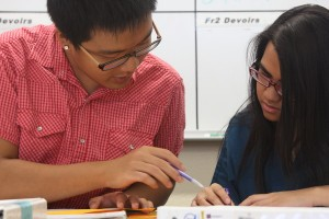 Junior Taylor Tang collaborates with his classmate as they try to solve a math problem. With his passion for mathematics, he makes quick work of the problem.<br/>Photo Credit: Jacob Berroya</strong>