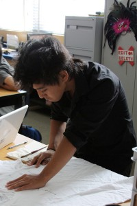 Freshman Tim Jauregui is finishing his T-shirt design for his group's anti-bullying campaign during 6th period on October 31, 2012.<br />Photo Credit: Shantil Gamiao