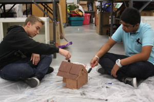 Sophomores Jaspreet Hira and James Lawrence are busy painting their Indian style model homes.<br/>Photo Credit: Raymond Tang