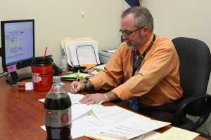 Mr. Michael Butler finishes up one of his last duties as the assistant principal at SWCTA.<br/>Photo Credit: Jenika Chiang