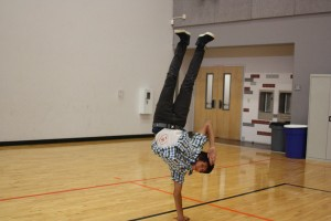 Freshman Juan Duarte practices his break moves in the gym at Break Club on Nov. 27.<br />Photo Credit: Jenika Chiang
