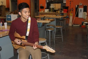 Senior Richard Dela Cruz practices his talents for singing and playing the guitar, which he has practiced for quite some years now.<br />Photo Credit: Bserat Ghebremicael
