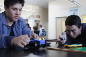 Sophomore Kristian Campanella and junior Joseph Alutro work together to finish the physics challenge.<br />Photo Credit: Jacob Berroya