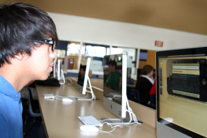 Errab Castro, junior, experiments with an iPhone simulator that he's thinking about using for the STEM App Challenge.<br />Photo Credit: Jared Ward