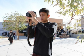 Vernon Datu, senior, takes his time as he attempts to capture the perfect scenery shot.Photo Credit: Shantil Gamiao