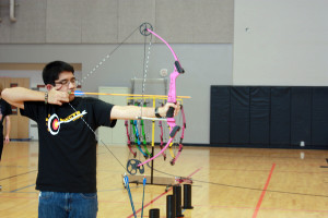 Kevin Rodriguez, freshman, is practicing the proper way to draw the bow before releasing his arrow.Photo Credit: Raymond Tang