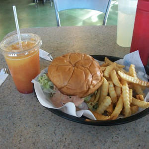 The St. Thomas burger is served with a heaping handful of fries and a separate order of the Sun Burn Tropical Smoothie. <br />Photo Credit: Saron Abraham