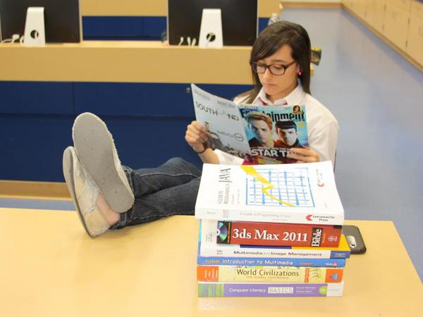 """A senior takes time to read a story on the new """"Star Trek"""" movie, instead of working on her homework for her classes. After seniors have received their acceptance letters, some lack the motivation to maintain satisfactory grades in their classes.<br>Photo Credit: Bserat Ghebremicael"""