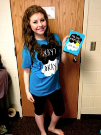 "Corey Tyndall relates her love of ""The Fault in Our Stars"" in her t-shirt choice for the day while preparing for class in her dorm at Brigham Young University.<br>Photo Credit: Corey Tyndall"
