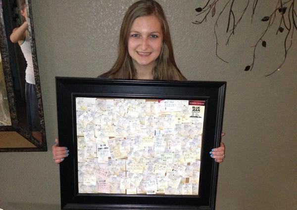 Senior Deianara Torres holds up a picture frame filled with movie ticket stubs and other stubs from performances she has attended.<br>Photo Credit: Deianara Torres