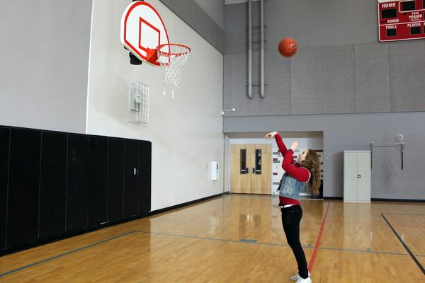 Sophomore Dzeneta Husic begins her basketball warm up routine by shooting a few hoops.<br>Photo Credit: Shantil Gamiao