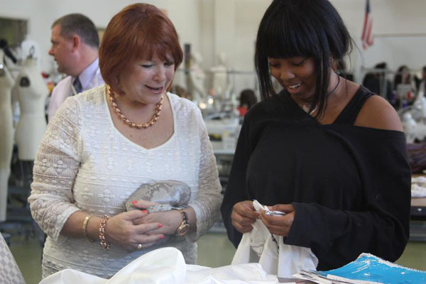 Junior Summer-Joi Cheatham receives feedback on her garments from FIDM executive Ms. Lisa Morabito.<br>Photo Credit: Jenika Chiang