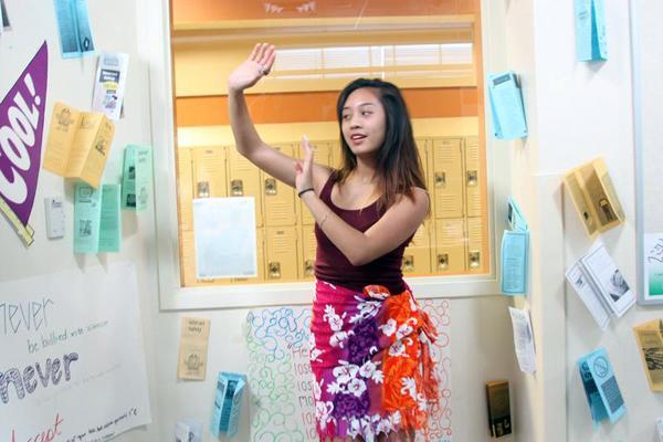 Tahitian dancer Jaysamia Barcelo-Dizon, freshman, <br>practices her island routine.<br>Photo Credit: Emiliano Alvarez