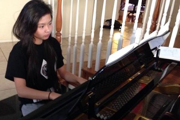 Freshman Linda Do practices her piece for her next recital.<br>Photo Credit: Jenika Chiang