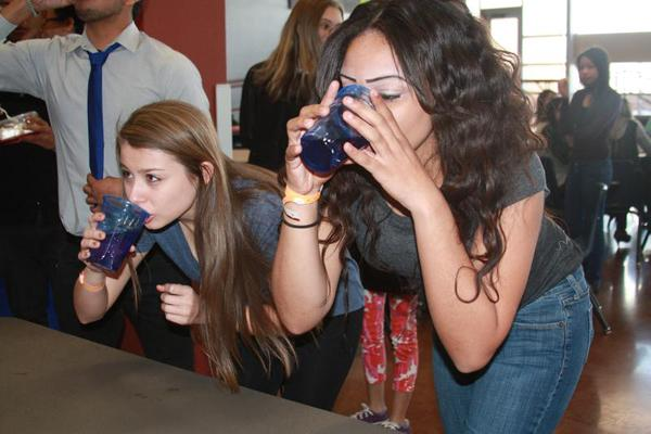 Sophomore Selena Gallegos and junior Dymond-Salter Goods chug water during Wednesday's lunchtime competition.<br>Photo Credit: Michelle Manuel