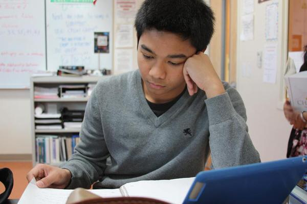 Senior Kevin Dionisio studies in Mr. Timothy VanKirk's classroom as part of the weekly tutoring currently available. Dionisio utilized the tutoring<br>during his sophomore year and passed the test.<br>Photo Credit: Shantil Gamiao
