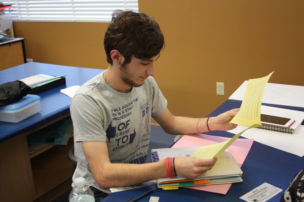 Junior John Muscari reviews the classes <br />he will take for his senior year.<br>Photo Credit: Tamara Navarro