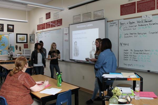 Sophomores in the Argentinian Revolution group, Sarah Kim, Mallory Gruber, YouJia Shi, Aubrey Deloe, and Sabrina Lightfoot elaborate on significant figures <br />that took part in the revolution.<br>Photo Credit: Shantil Gamiao